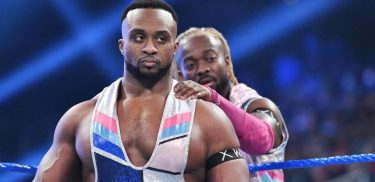 Big E is encouraged by Kofi Kingston (in background) as he prepares for a match against John Morrison on SmackDown.