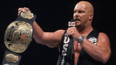 Steve Austin with his Smoking Skull title belt