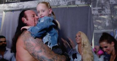 The Undertaker backstage with his daughter